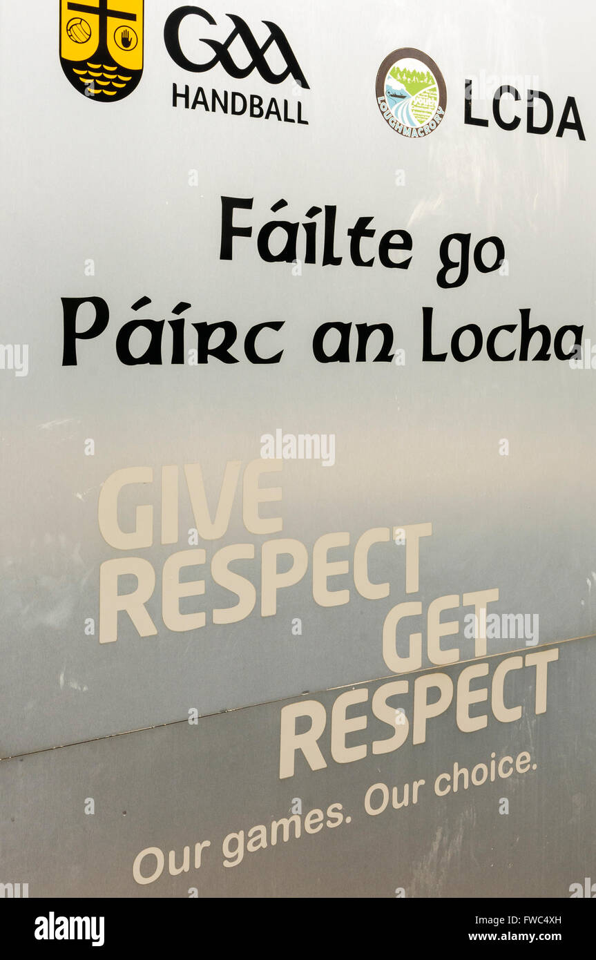 """Loch mhic Raurí GAA grounds, Loughmacrory, County Tyrone, Northern Ireland with the motto """"Give respect, get respect"""" Stock Photo"""