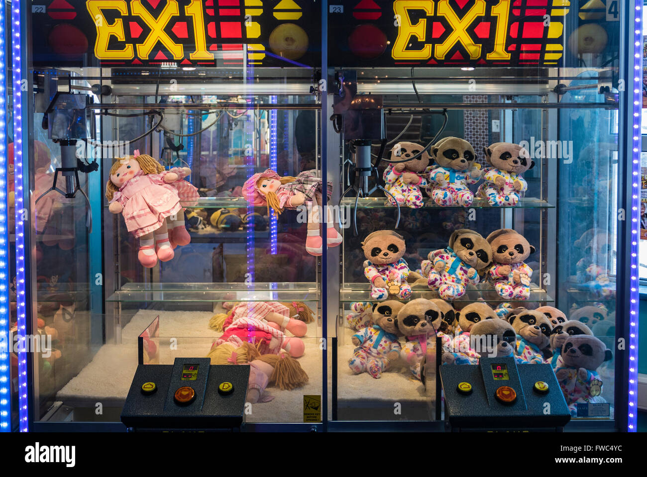 Toy grab claw machine at a funfair arcade - Stock Image
