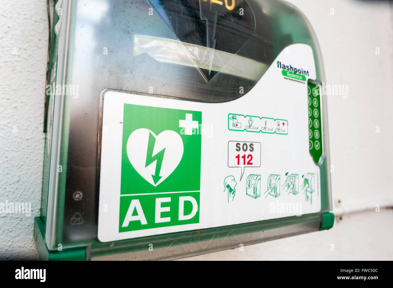 Automated External Defibrillator (AED) inside a case with a key code lock to prevent unauthorised removal. - Stock Image