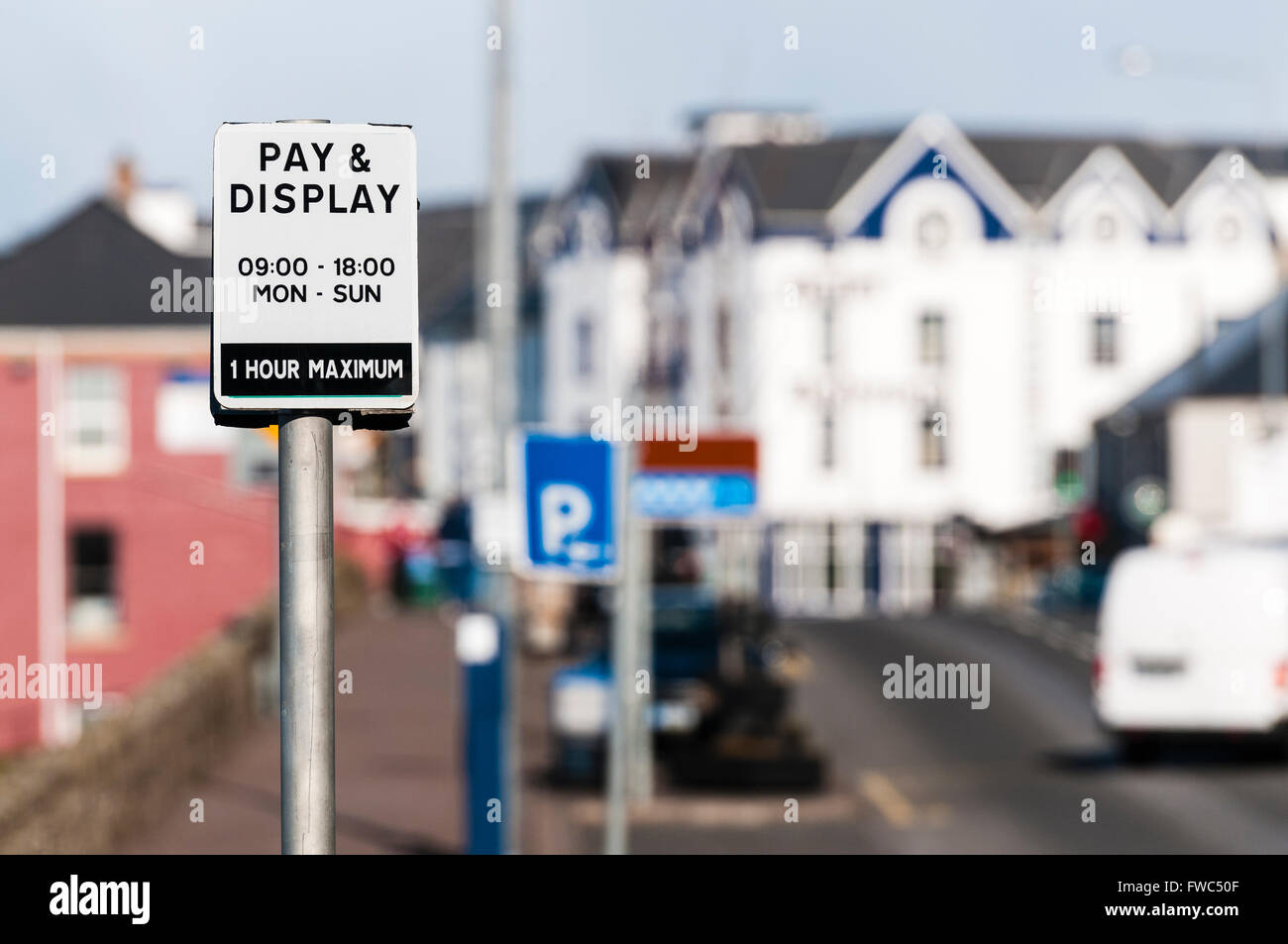Sign for on-street pay and display car parking, 9am to 6pm, 1 hour maximum. - Stock Image