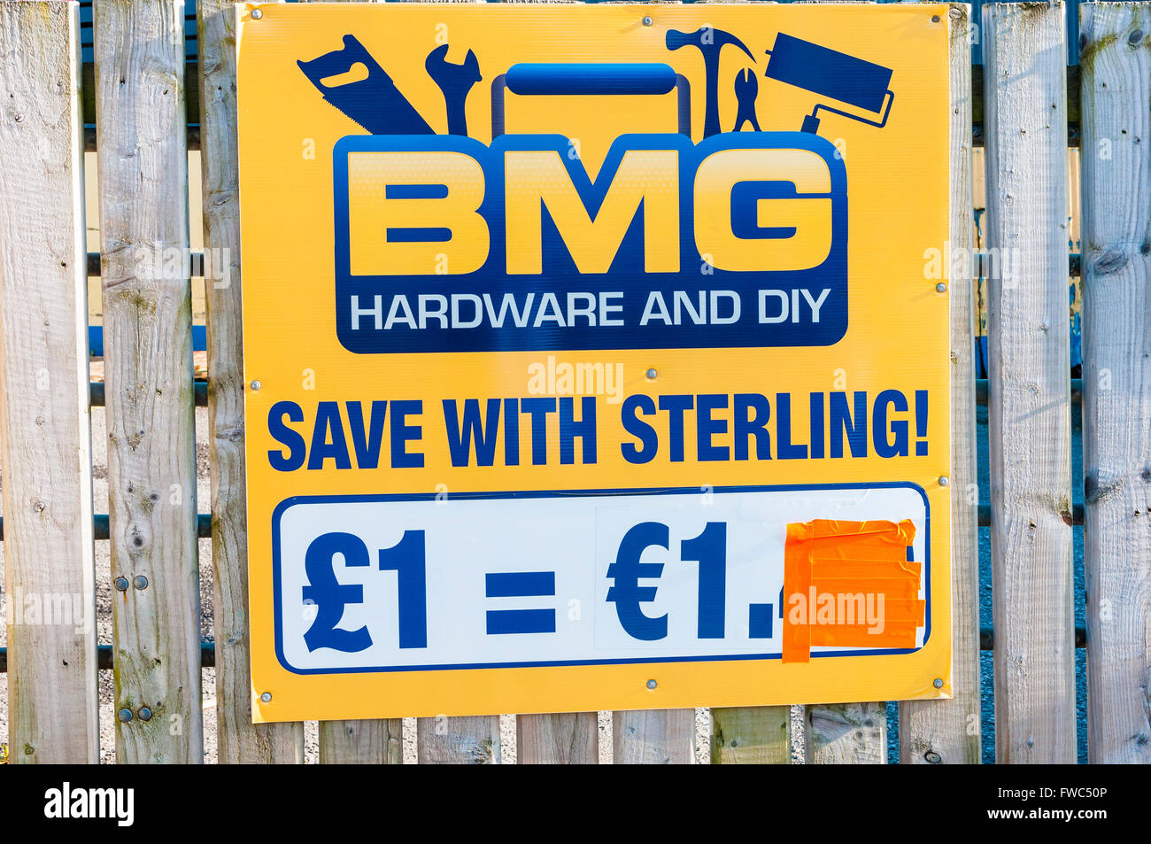 Sign at a hardware store giving equity between Sterling and Euro and saying 'Save with Sterling' - Stock Image