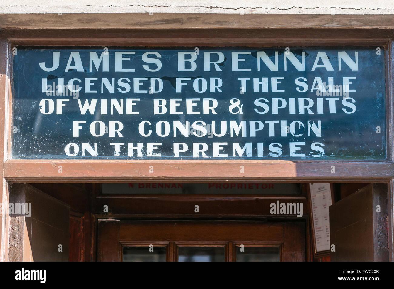 Sign above the door of Brennan's Irish pub.  Bundoran, Ireland - Stock Image