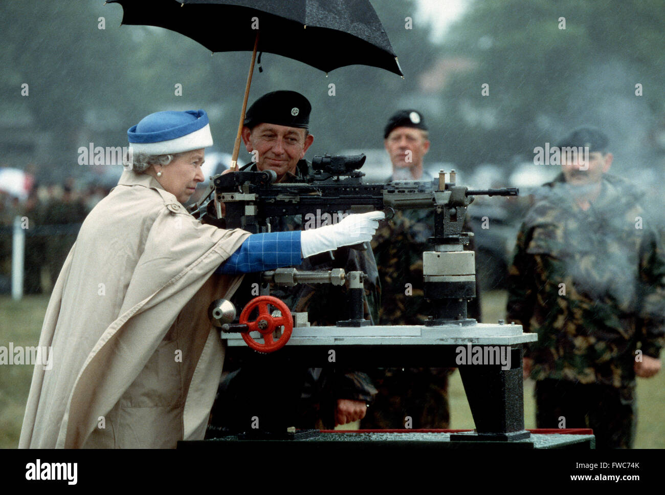 HM Queen Elizabeth II fires a rifle during a visit to the Army rifle association at Bisley, England July 1993 Stock Photo
