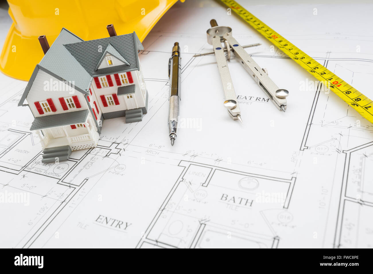 Peachy Model Home Measuring Tape Hard Hat Pencil And Compass Resting On Wiring Digital Resources Dimetprontobusorg