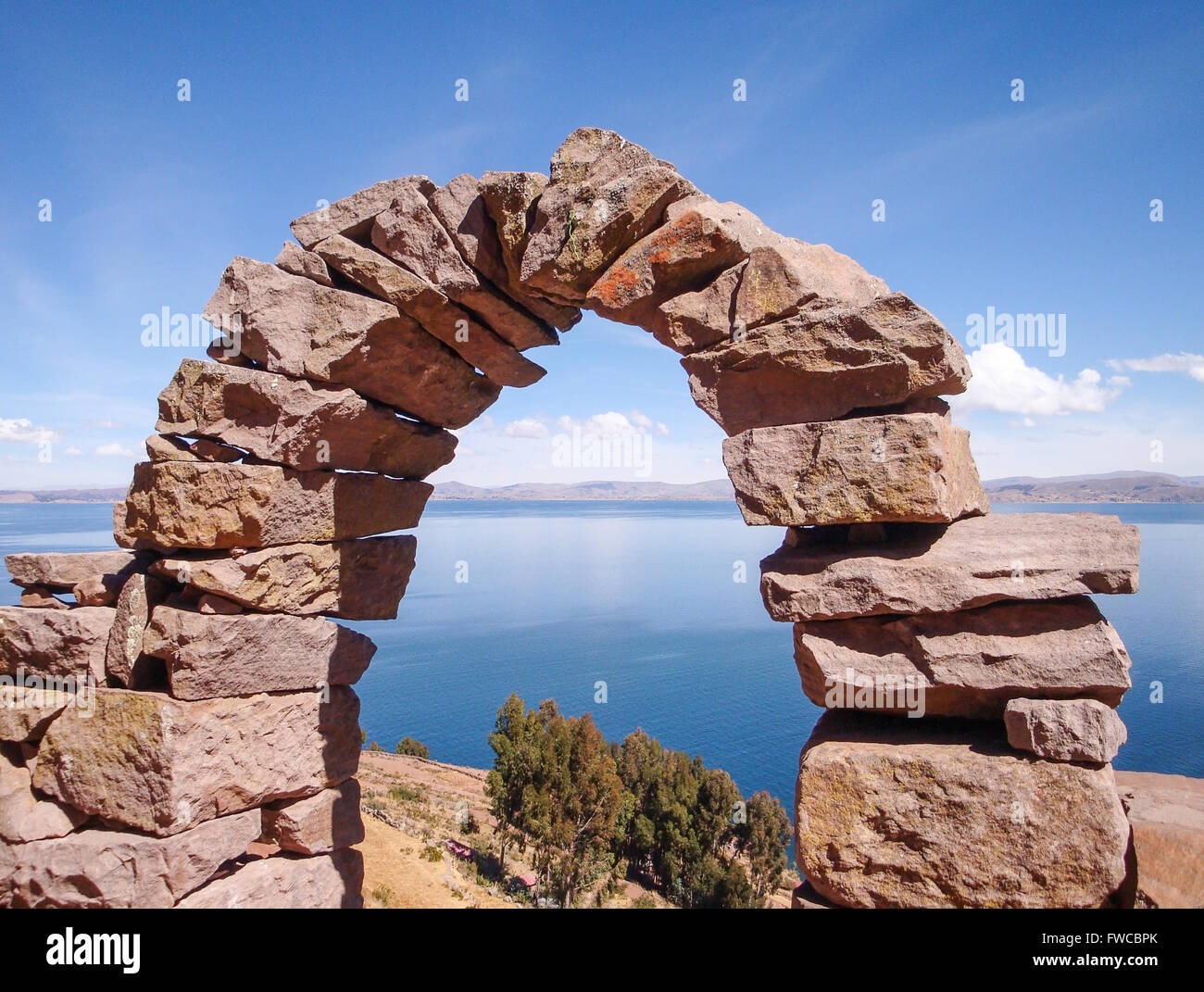 andes scenery with arch made of stone at Lake Titicaca in Peru (South America) - Stock Image