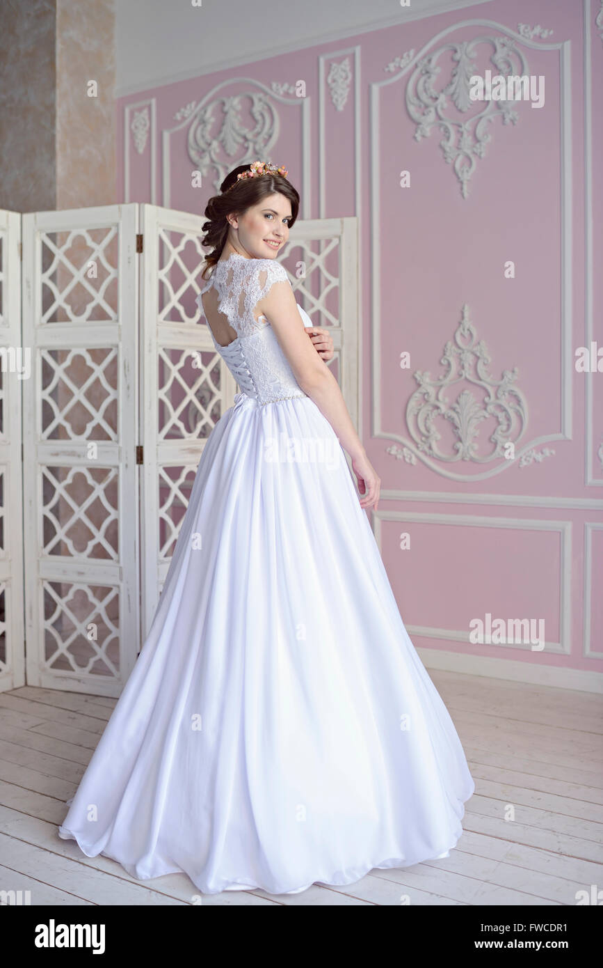 Beauty bride in bridal gown indoors. Beautiful model girl in a ...