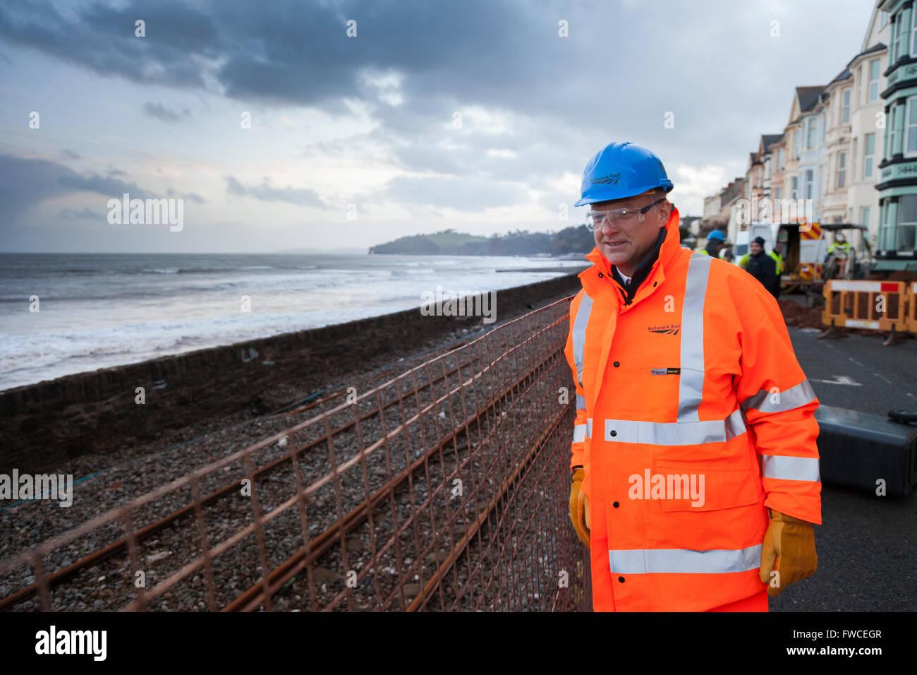 05/02/13 Network Rail Chief Exec Mark Carne inspecting storm damage at Dawlish, Devon, England. - Stock Image