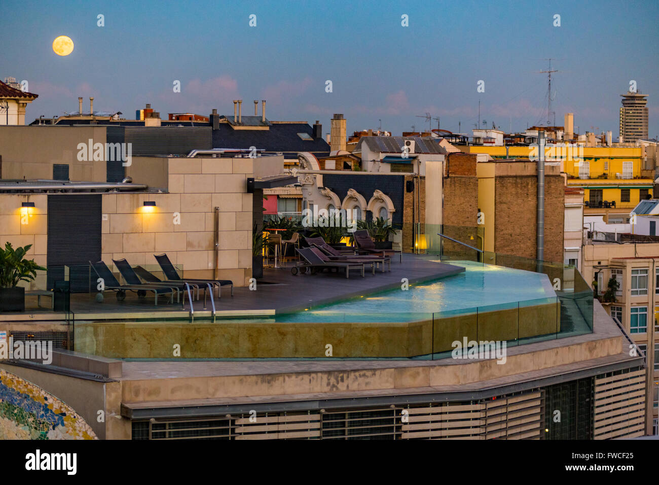 Moon over rooftop pool, Barcelona, Catalonia, Spain - Stock Image