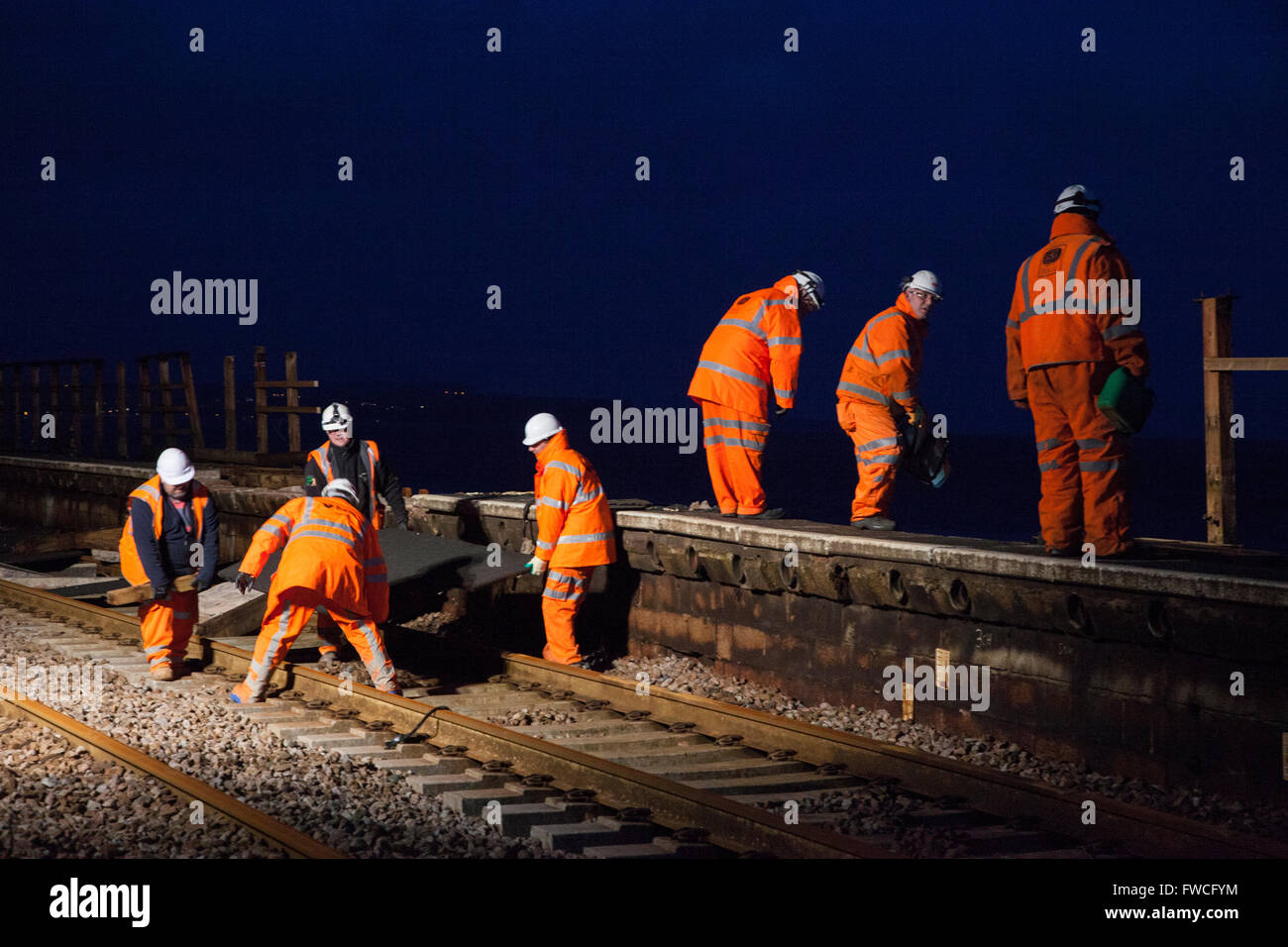 05/02/13 repairing the railway line damage due to heavy seas and storms at Dawlish, Devon, England. - Stock Image