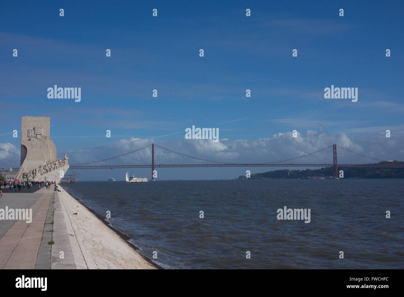 Discoveries monument with the 25th of April bridge behind, Lisbon, Portugal. - Stock Image