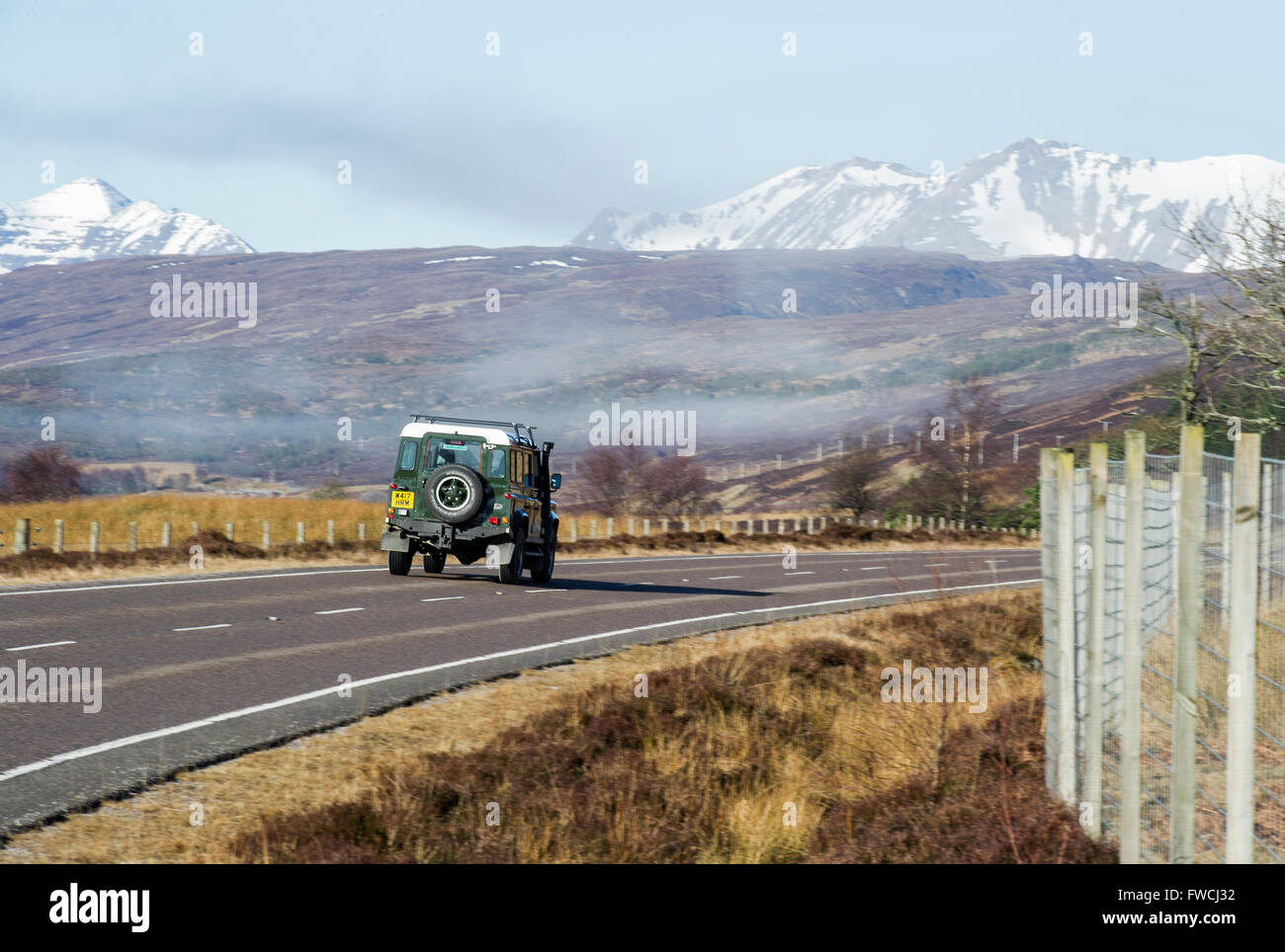 Land Rover 4x4 car alone on a remote Scottish Highland road, part of the North Coast 500 route - Stock Image