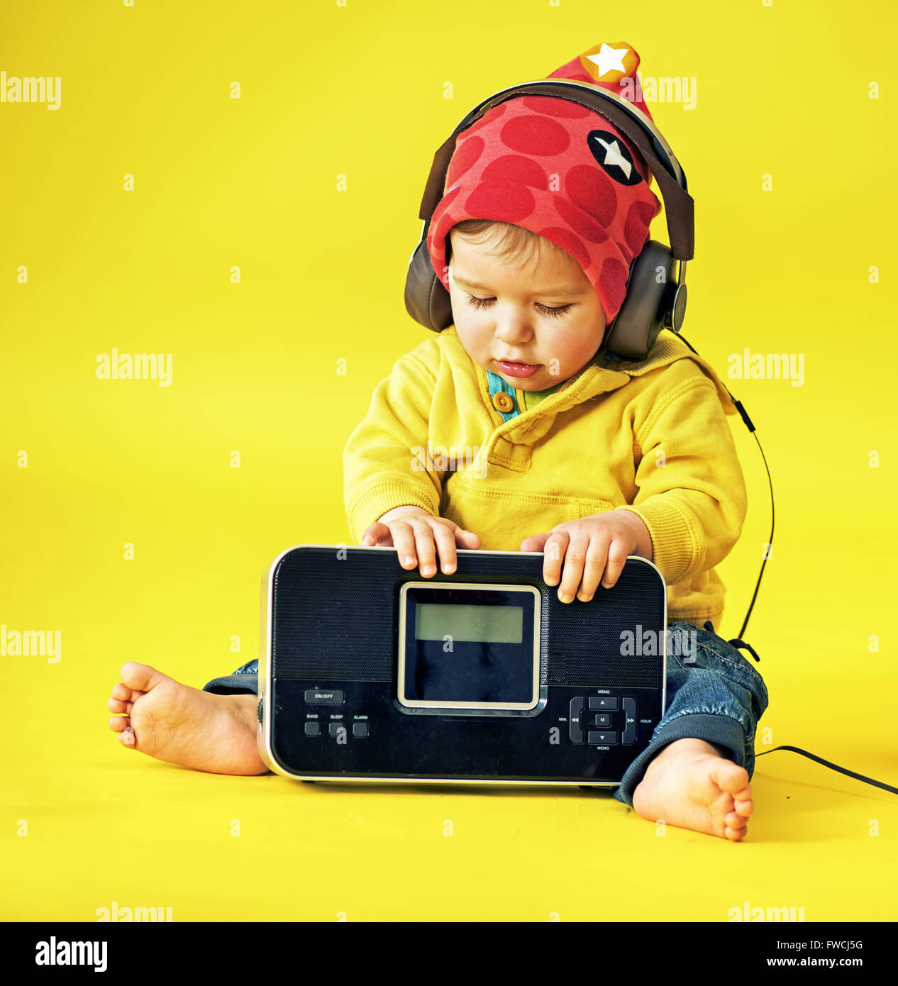 Happy little boy wearing headphones - Stock Image