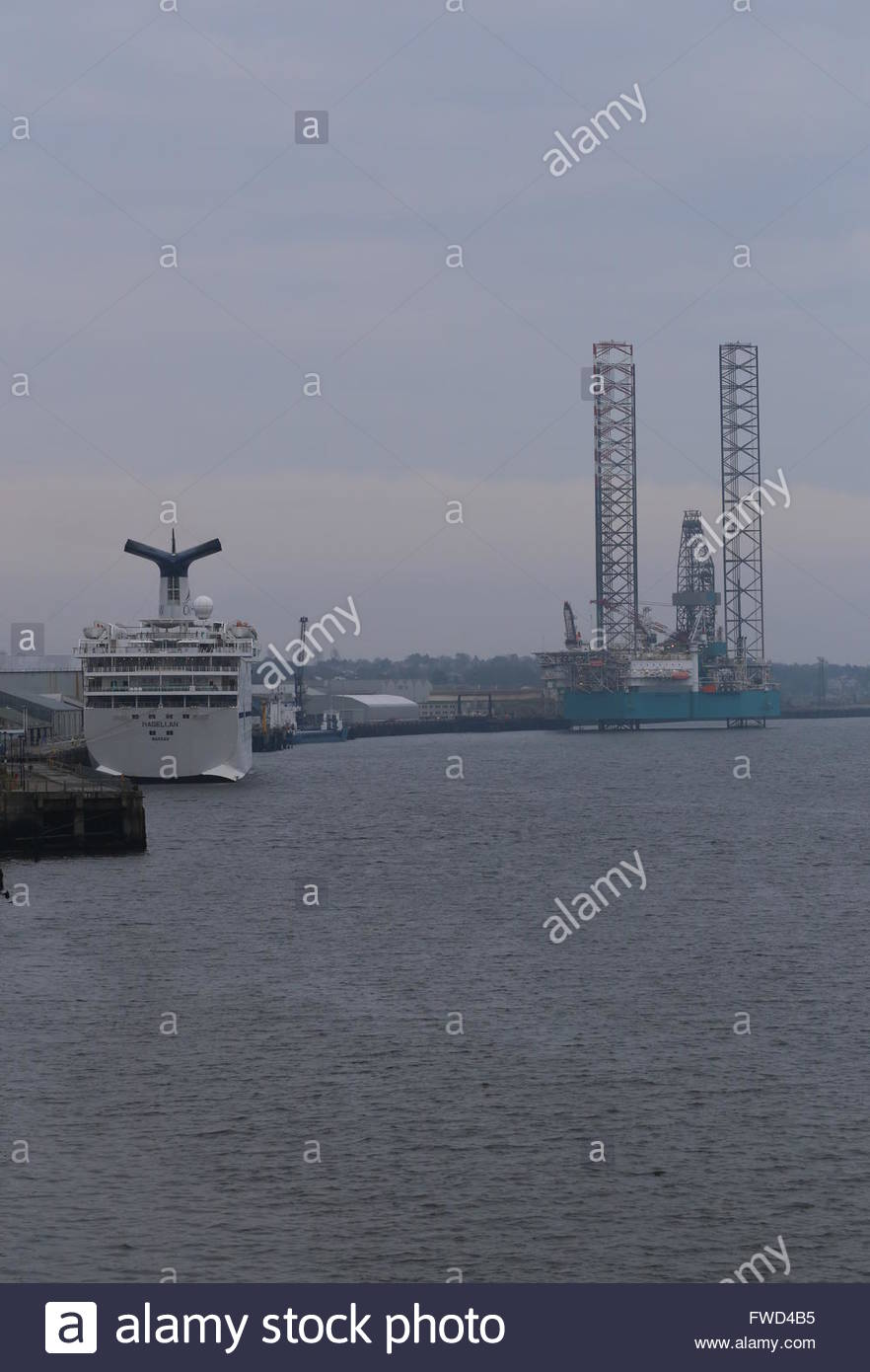 CMV cruise ship Magellan docked and oil rig under repair Dundee Scotland  3rd April 2016 - Stock Image