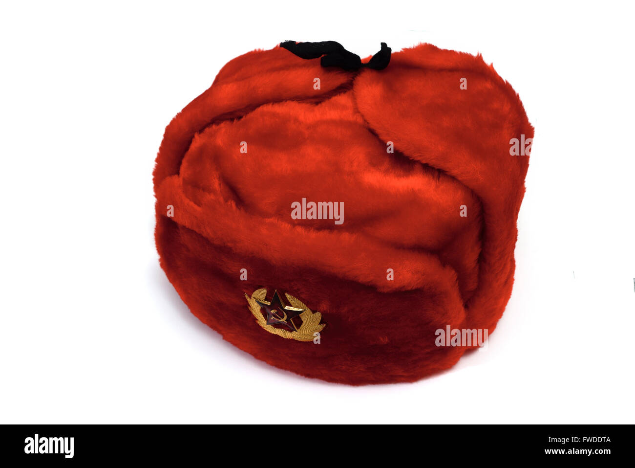 red fur hat with a badge on white background - Stock Image