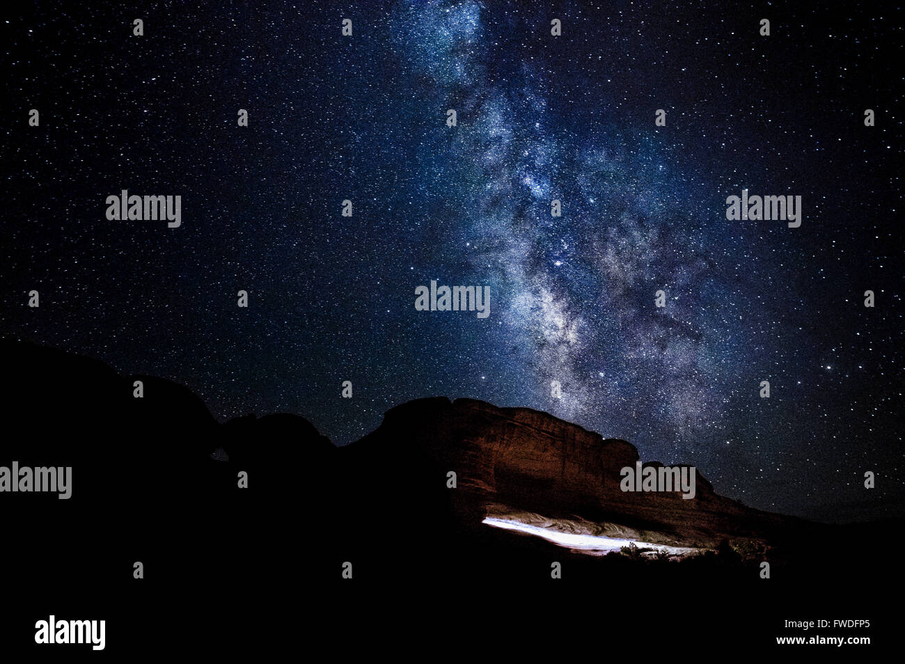 The Milky Way rising over the path to Delicate Arch in Arches National Park, Utah. - Stock Image