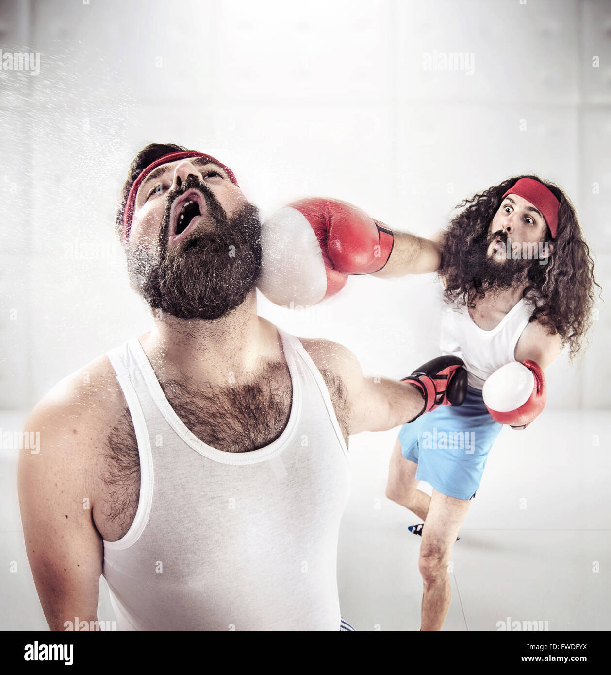 Two nerdy pals boxing on the ring - Stock Image