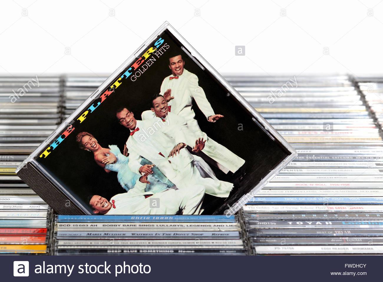 The Platters Golden Hits album, piled music CD cases, Dorset England - Stock Image