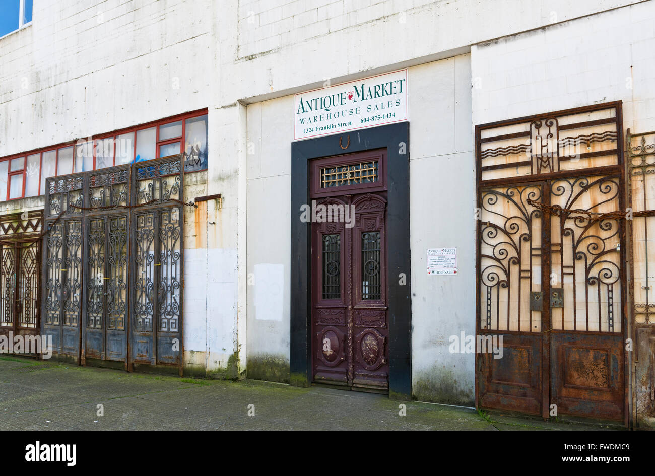 Entrance to Antique Market on Franklin Street in East Vancouver. Ornate  metal iron doors grates. Building exterior - Entrance To Antique Market On Franklin Street In East Vancouver