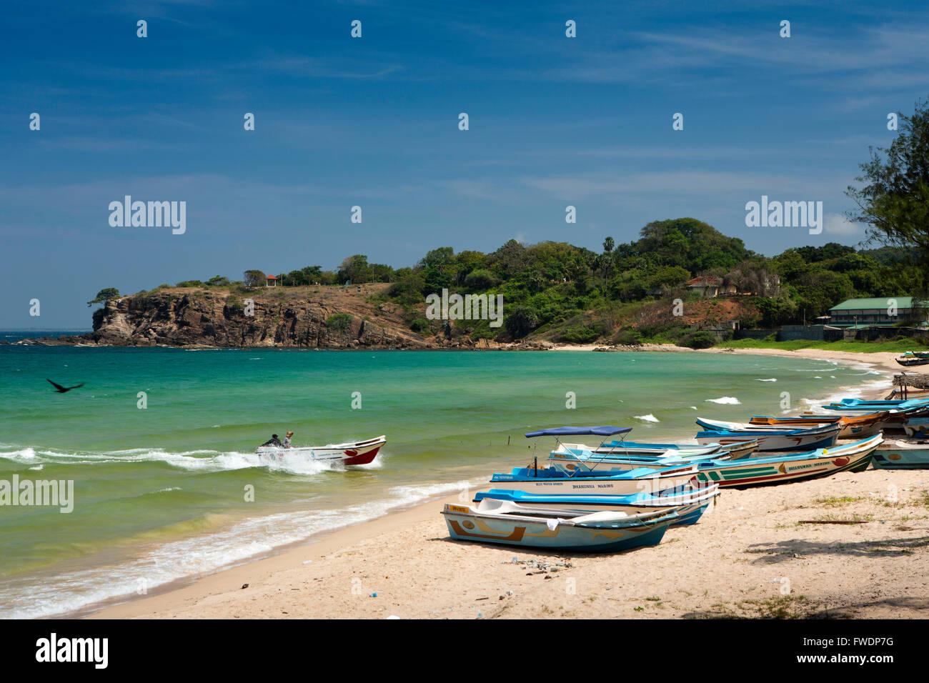 Sri Lanka, Trincomalee, Dutch Bay, fishing boats returning to the beach - Stock Image