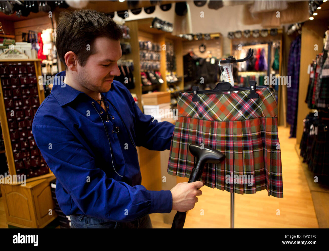 EdinburghScotland Man Steam Ironing A Tartan Mini Skirt