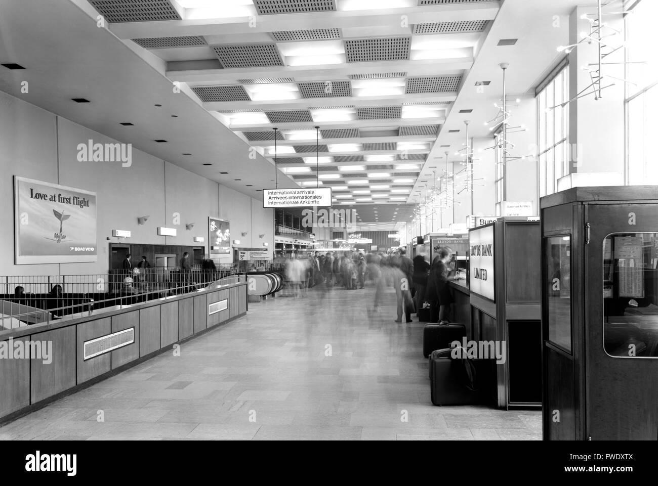 International Arrivals Hall at Terminal 2 Heathrow Airport taken on a half-plate camera around 1970. Note the unattended - Stock Image