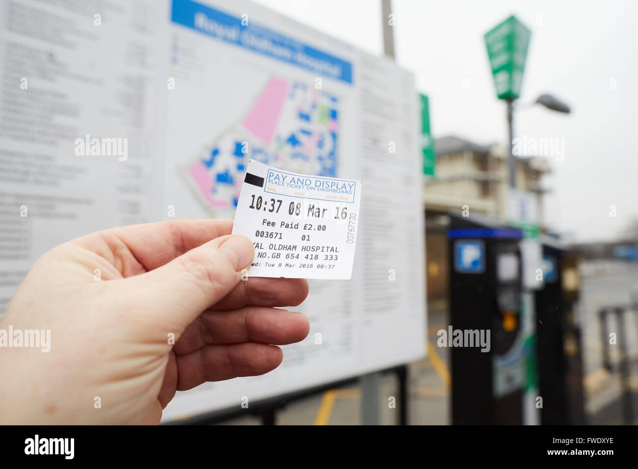 Oldham Royal Pennine Acute Hospitals NHS Trust parking ticket in hand - Stock Image