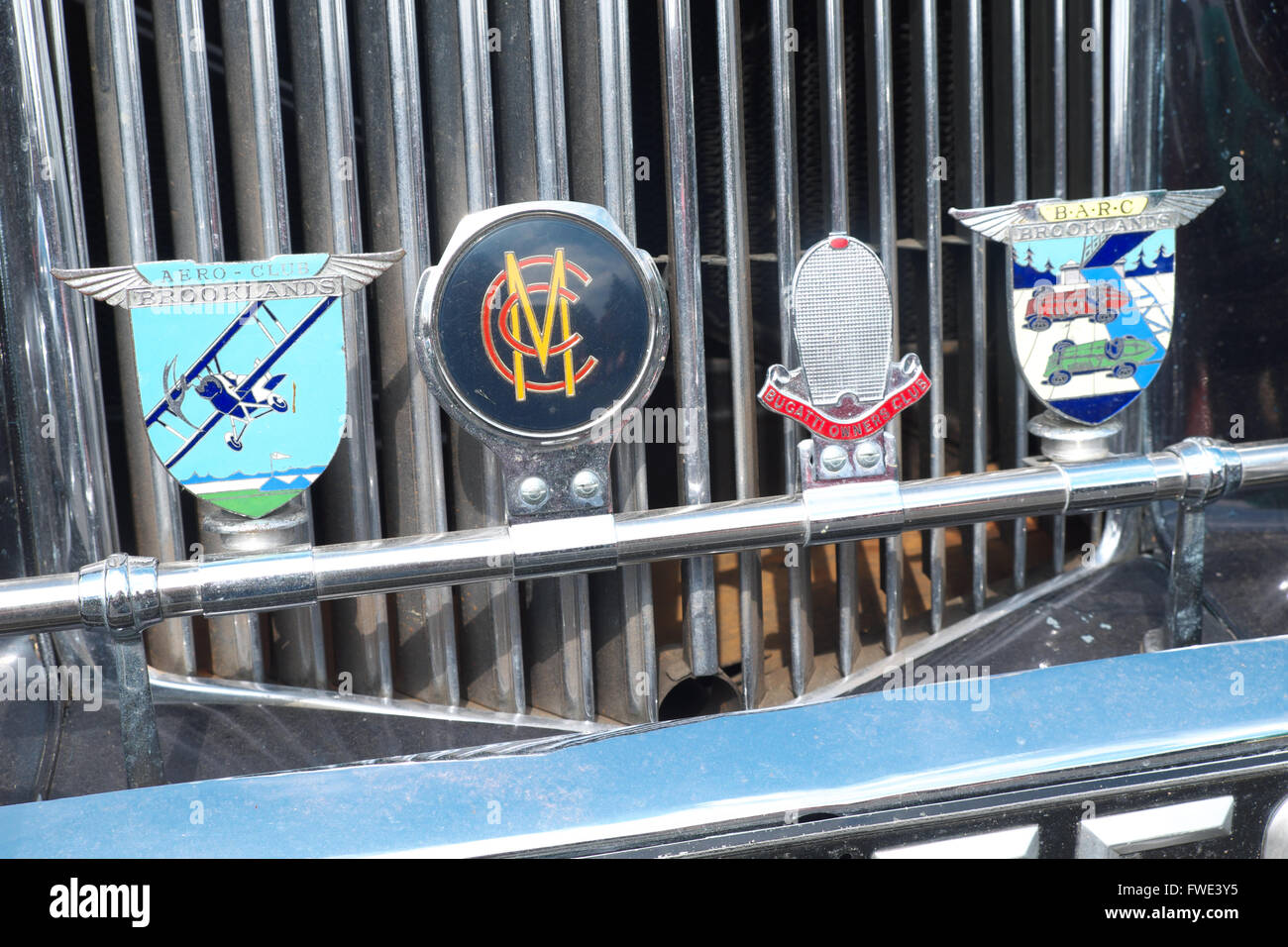 Badges on a car radiator grill including Brooklands Aero Club on left and Marylebone Cricket Club second from left Stock Photo