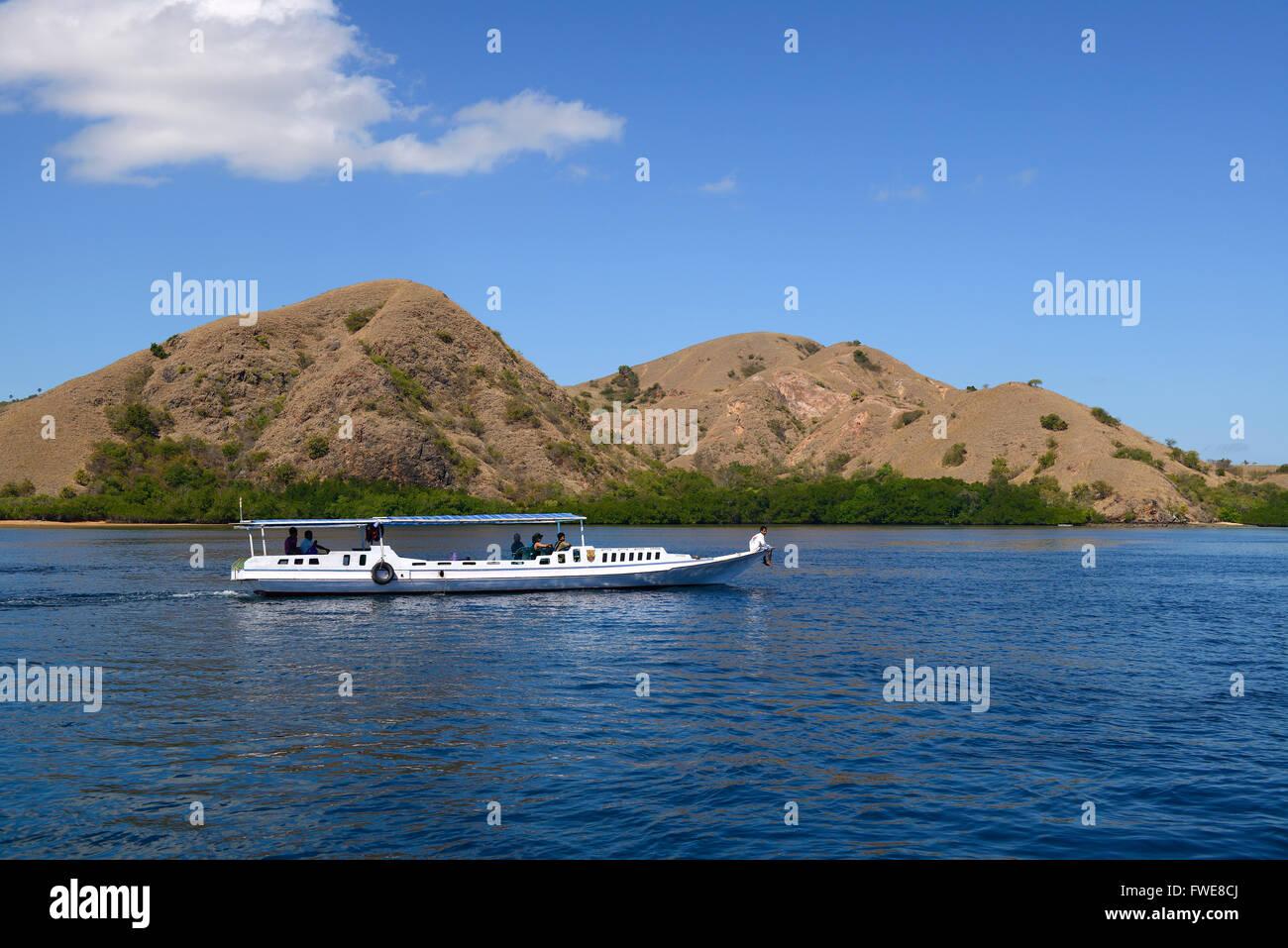 Typical tourist ship anchoring off Rinca Island, Komodo National Park, UNESCO World Heritage Site, Indonesia - Stock Image