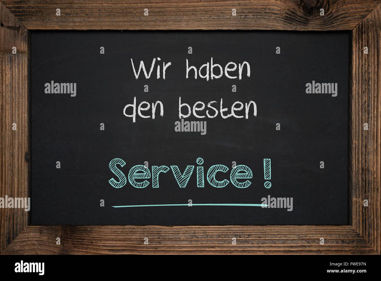 Chalkboard handwriting business success in German. - Stock Image