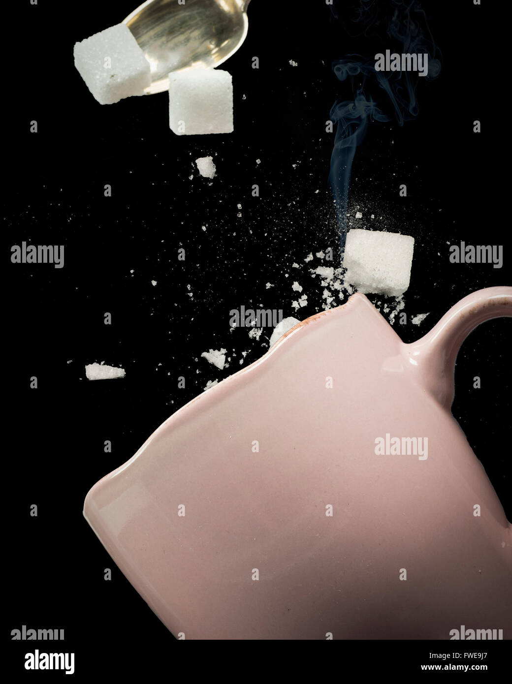 Sugar cubes misses the cup - Stock Image