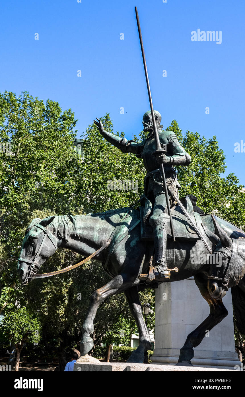 Bronze sculptures of Don Quixote.  Plaza de España is a large square, and popular tourist destination, located - Stock Image
