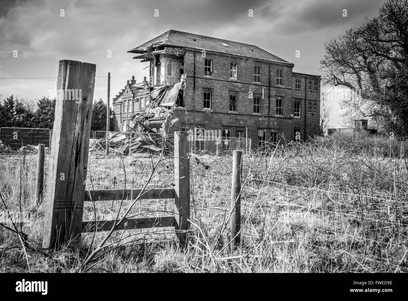 St Peters Boys School in Gainford, County Durham mid-way through being demolished. - Stock Image