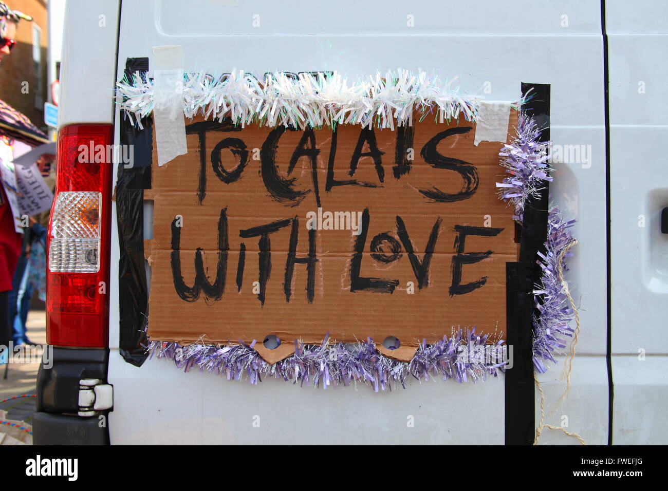 Anti Fascist groups decorate a  van, part of an aid convoy sent to the Calais migrant camp . Dover, Kent, UK. - Stock Image