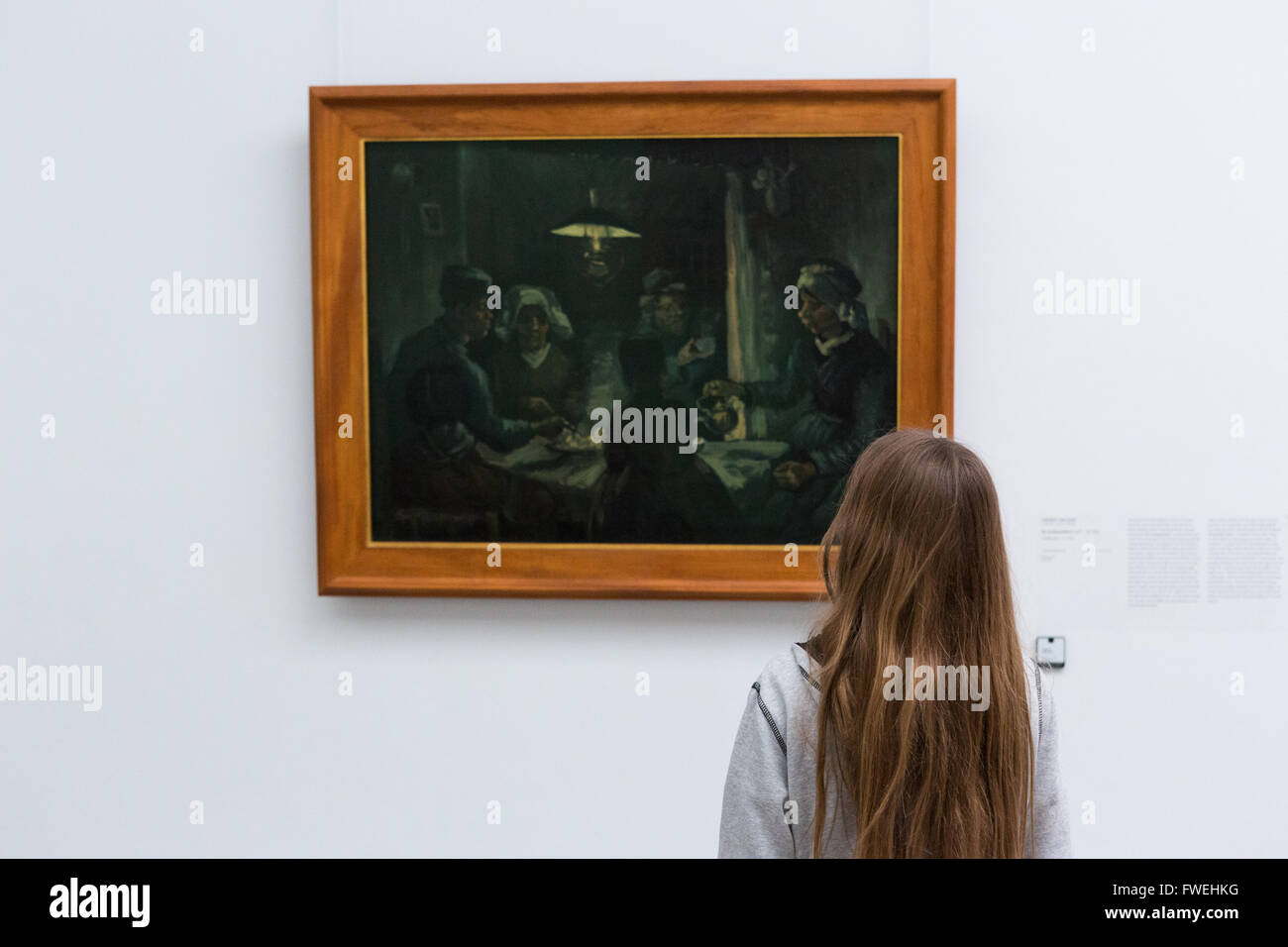 A visitor to Kröller-Müller Museum in Hoge Veluwe National Park, Netherlands, looks at The Potato Eaters - Stock Image