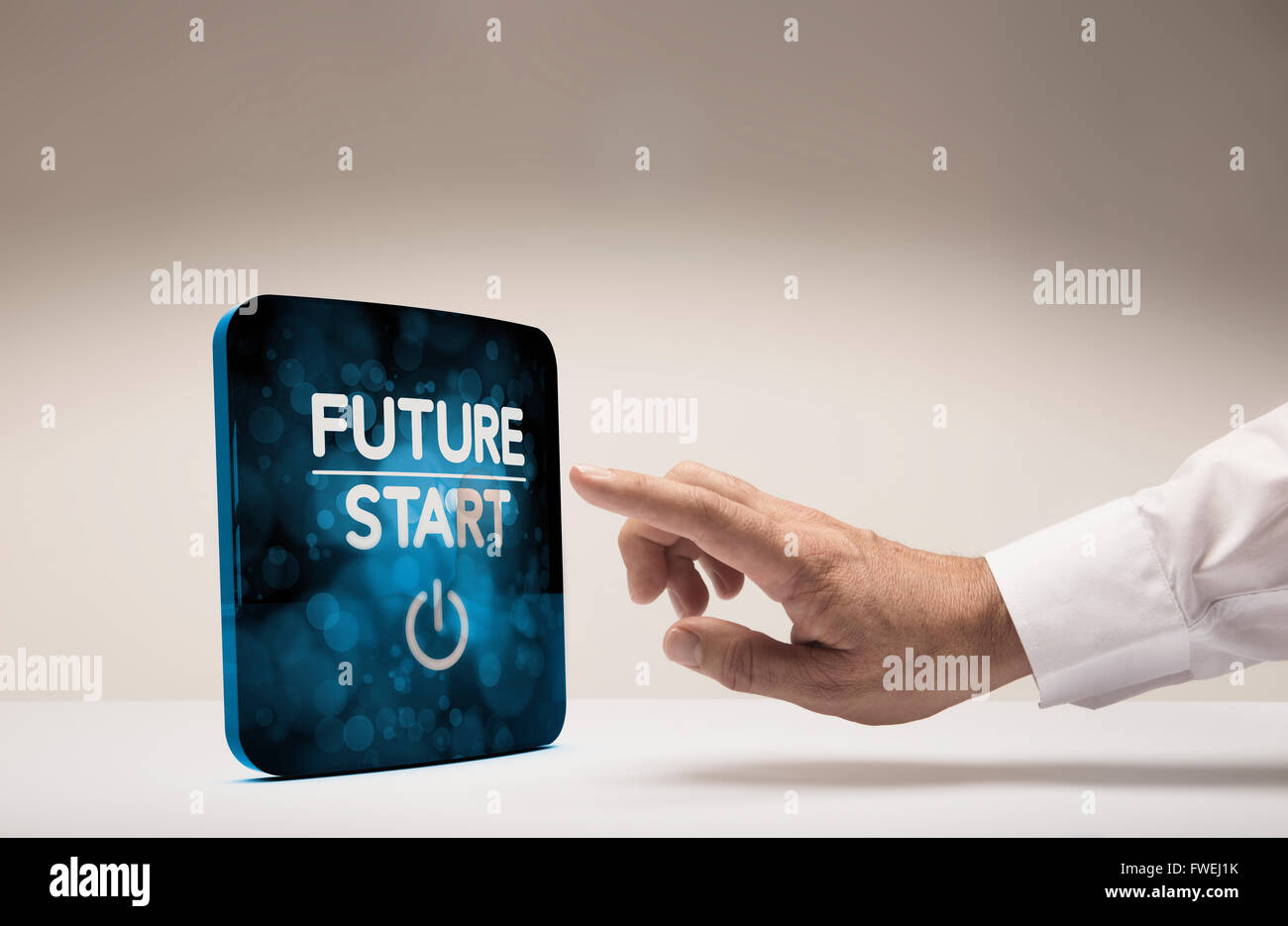 Finger about to press modern screen with the text future start, beige background. Concept image for illustration - Stock Image