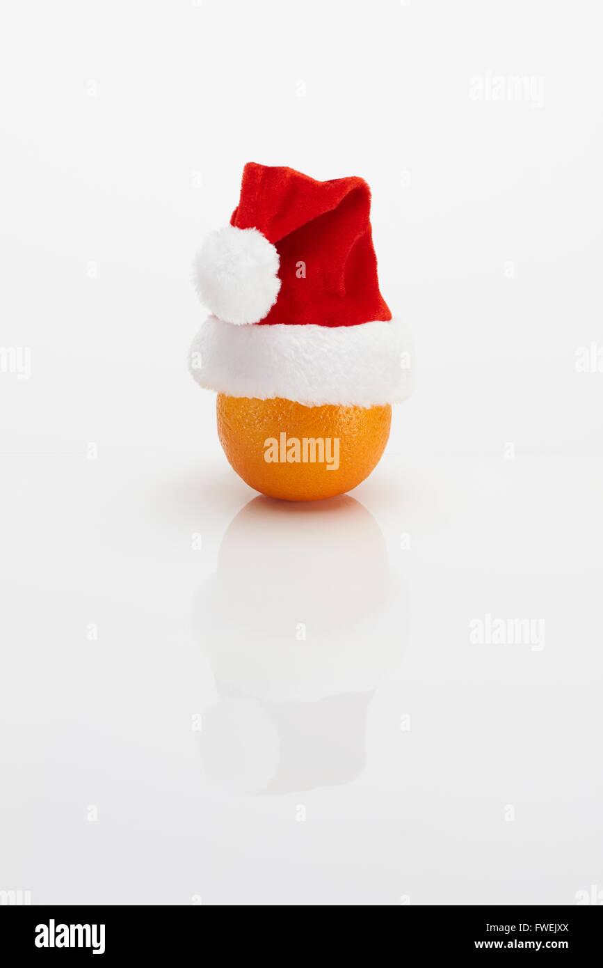 Orange with Christmas Hat Stock Photo