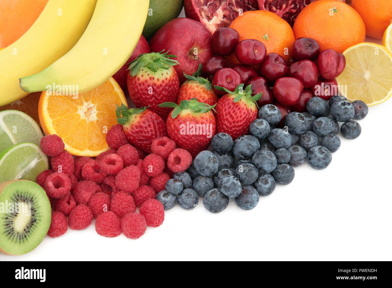 Fresh mixed fruit super food background selection with fruits high in antioxidants, vitamin c and dietary fiber Stock Photo
