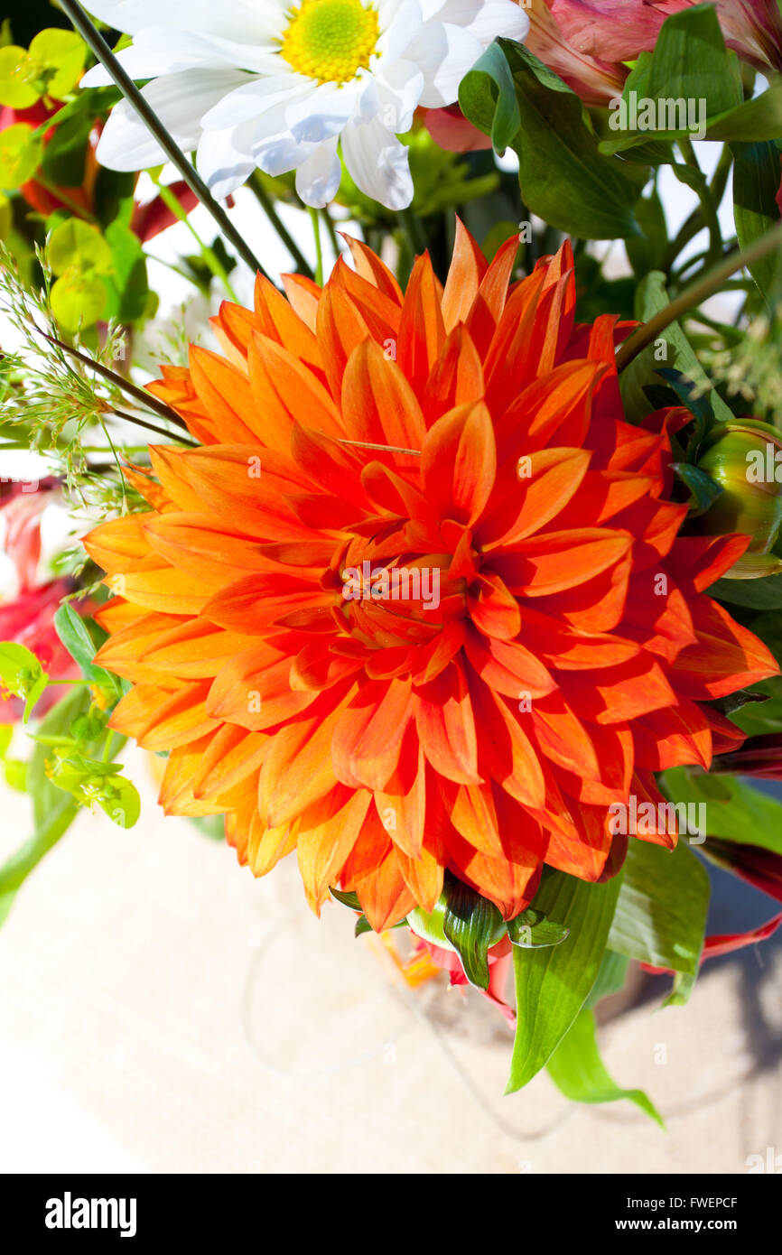 White Orange And Green Wedding Flower Arrangements With Burlap As