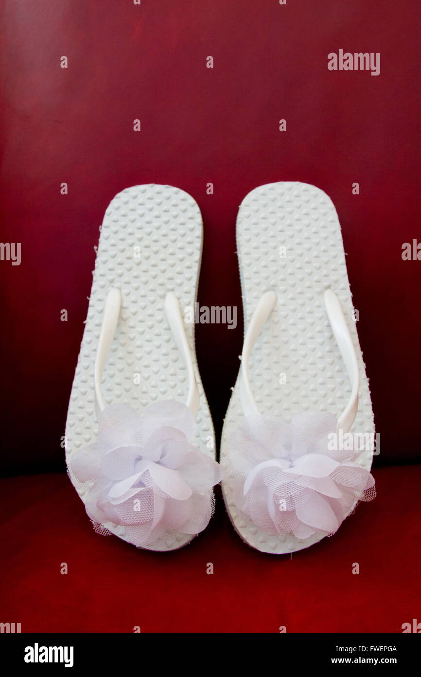 cf97f752eebed Simple white flip flop sandals for a bride to wear on her wedding day.
