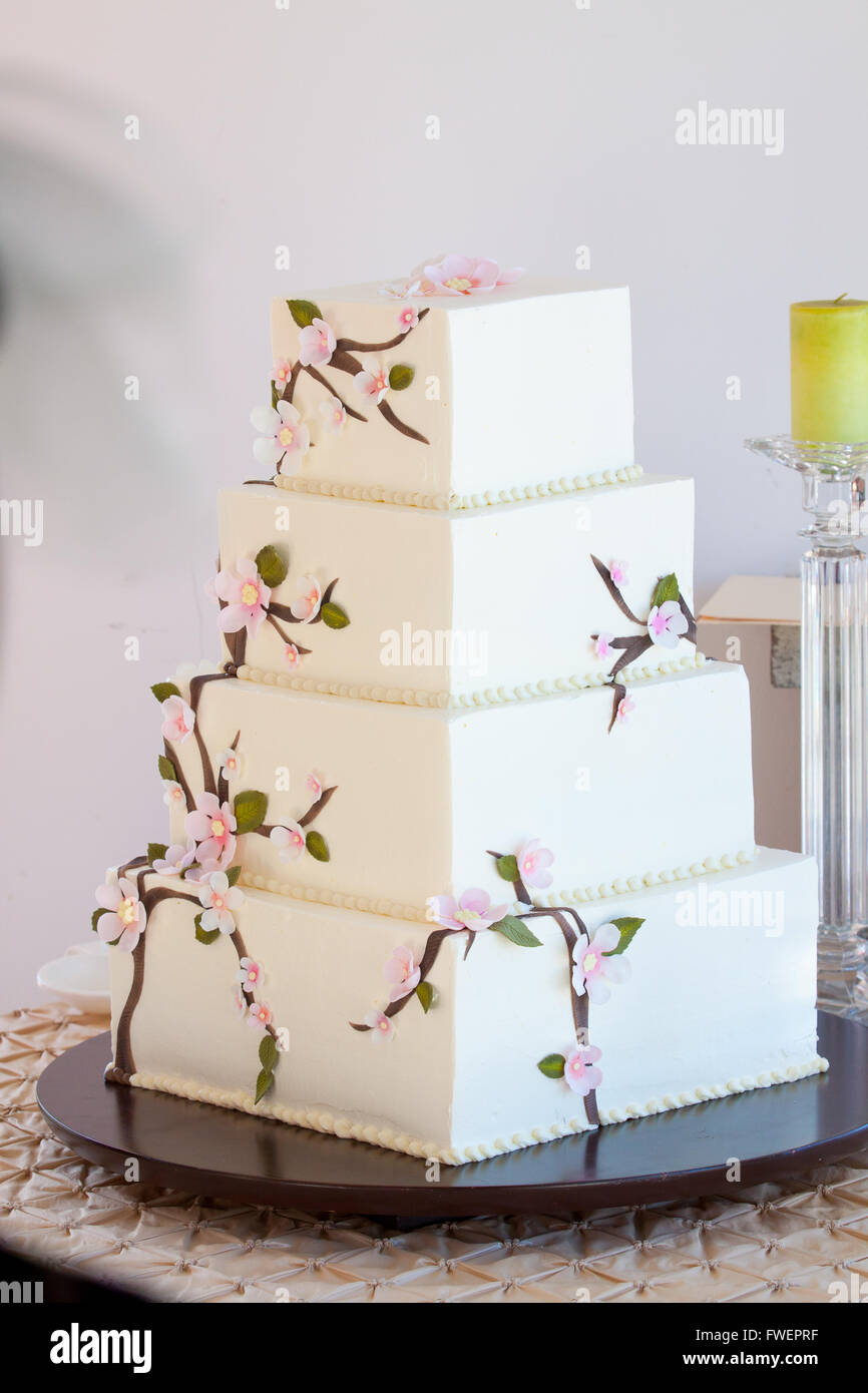 A very traditional white wedding cake at the reception for a bride ...