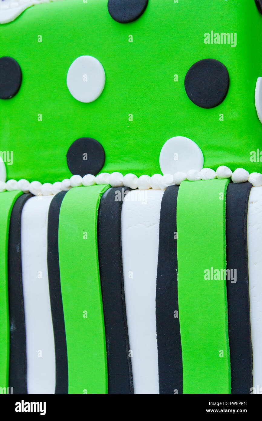 A Very Non Traditional Wedding Cake With White Green And Black And