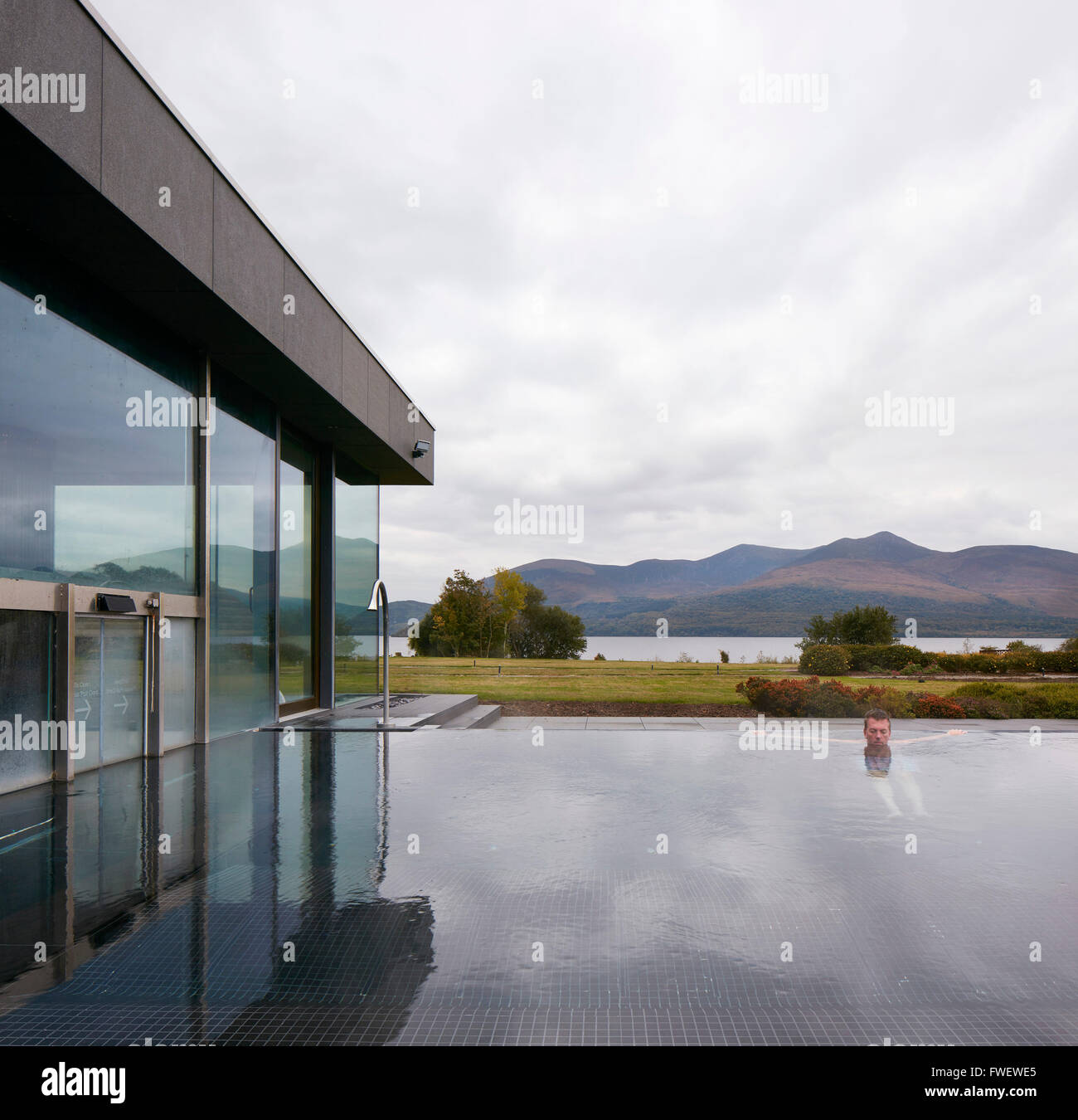 Outdoor pool with bather. The Europe Hotel, Killarney, Ireland. Architect: Gottstein, 2015. - Stock Image