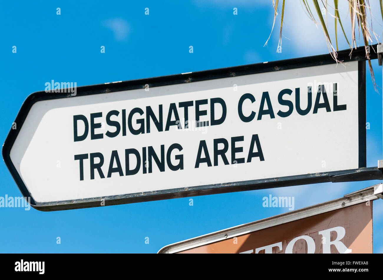 Direction sign for a 'Designated Casual Trading Area' for a town market. - Stock Image