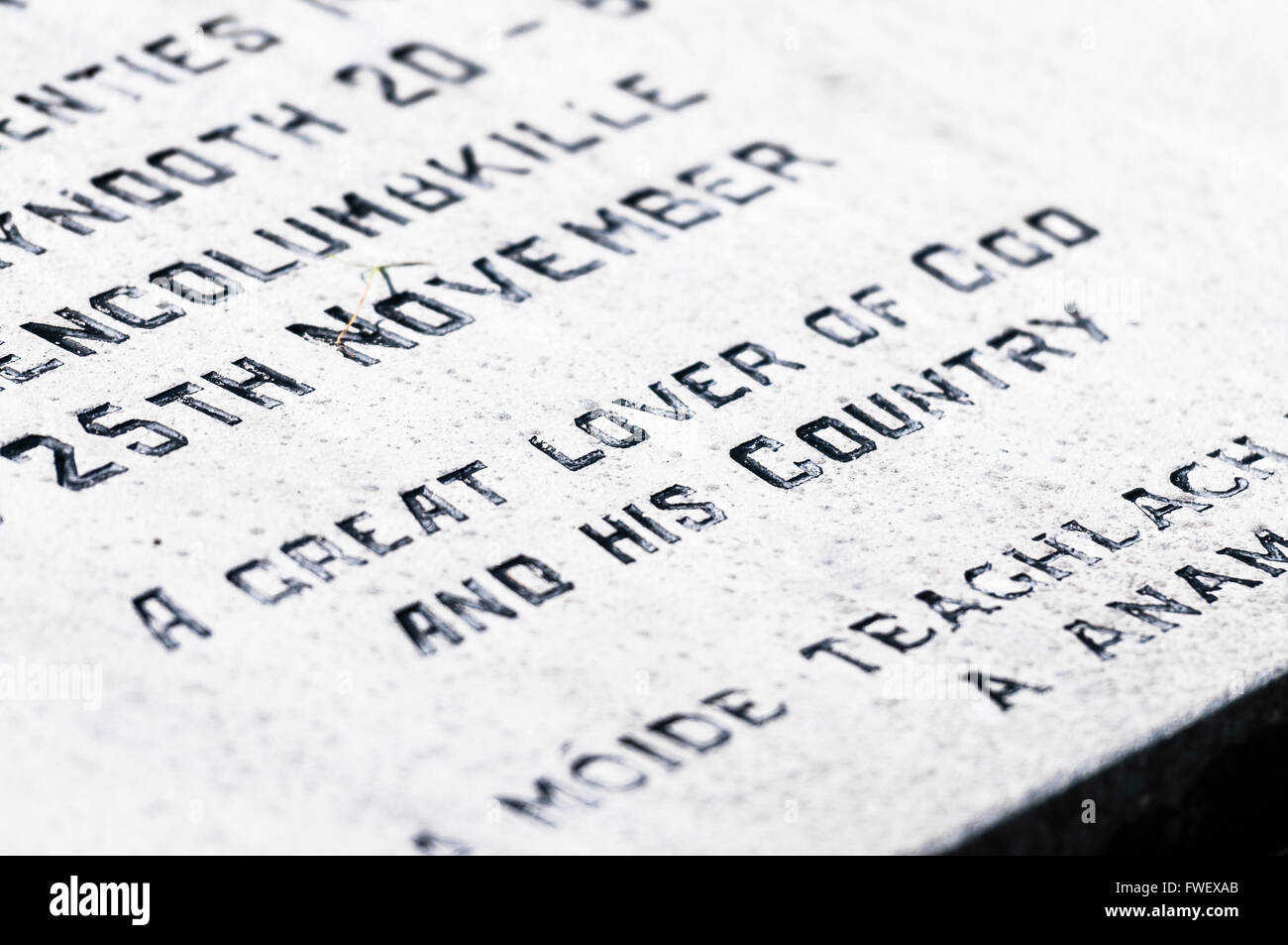 Inscription on the gravestone of an Irish Priest in an Irish graveyard saying 'A great lover of god and his - Stock Image