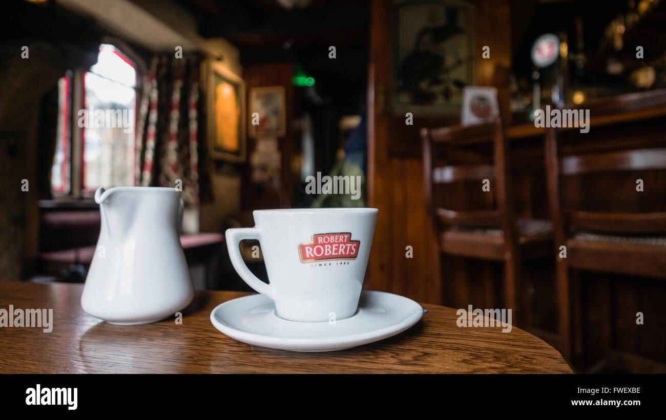 Robert Roberts coffee on the table of an Irish Pub. - Stock Image