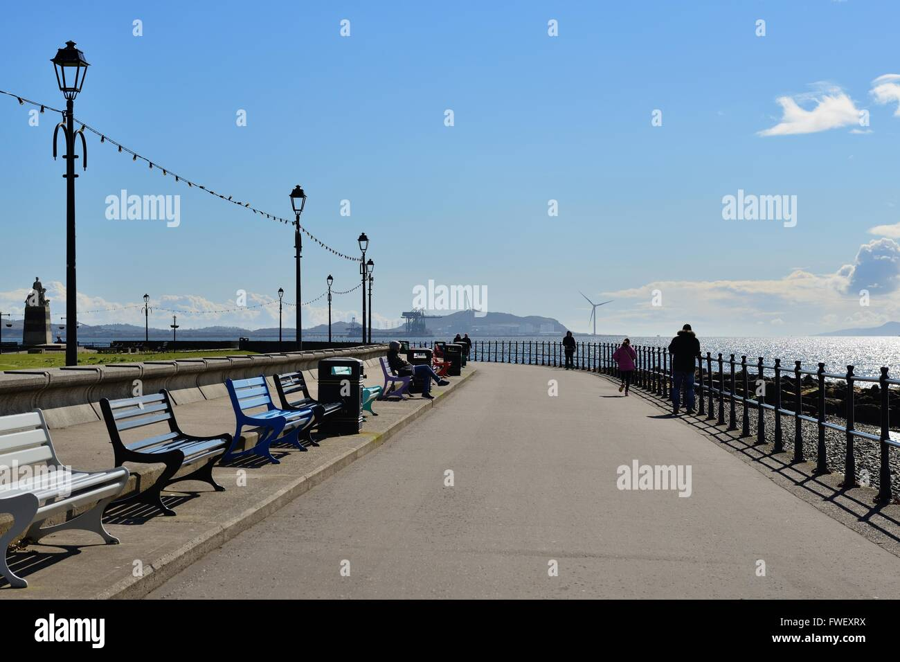 View of the Largs seafront promenade and Hunterston in the horizon. - Stock Image