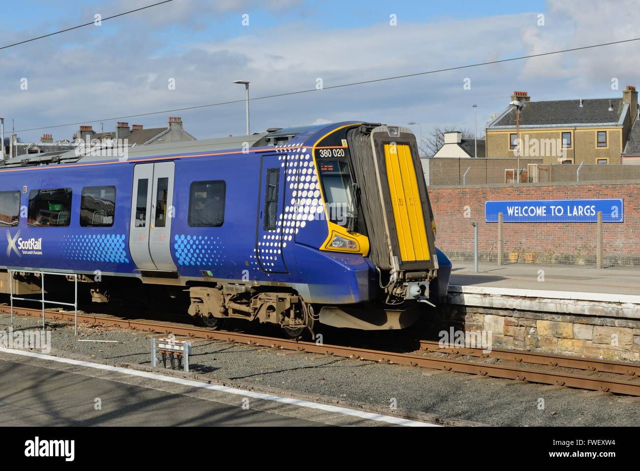 A Scotrail train alongside the platform in Largs station, Ayrshire, Scotland, UK - Stock Image
