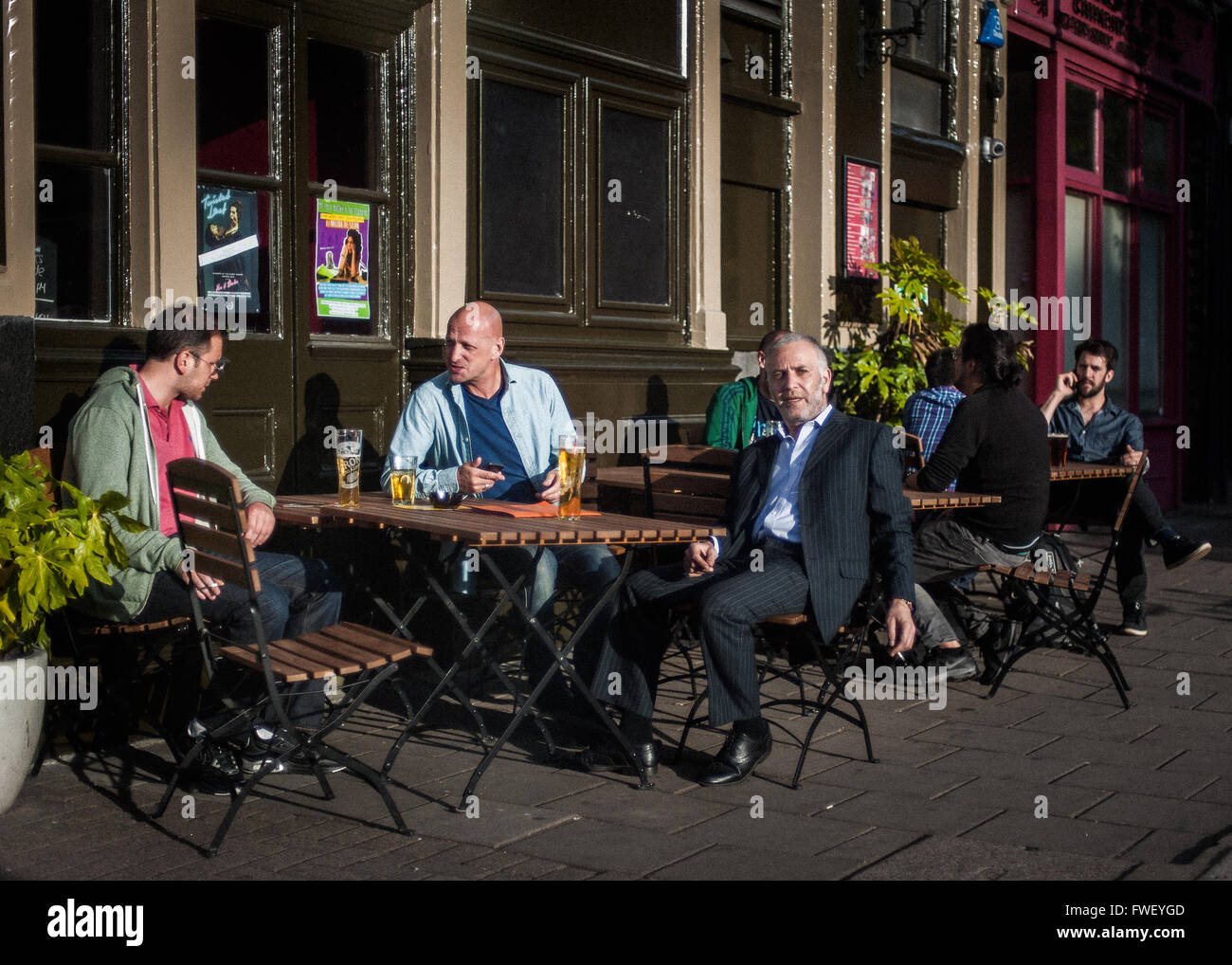 Punters sitting outdoors at pub,sunny summer late afternoon, Islington, London, UK - Stock Image