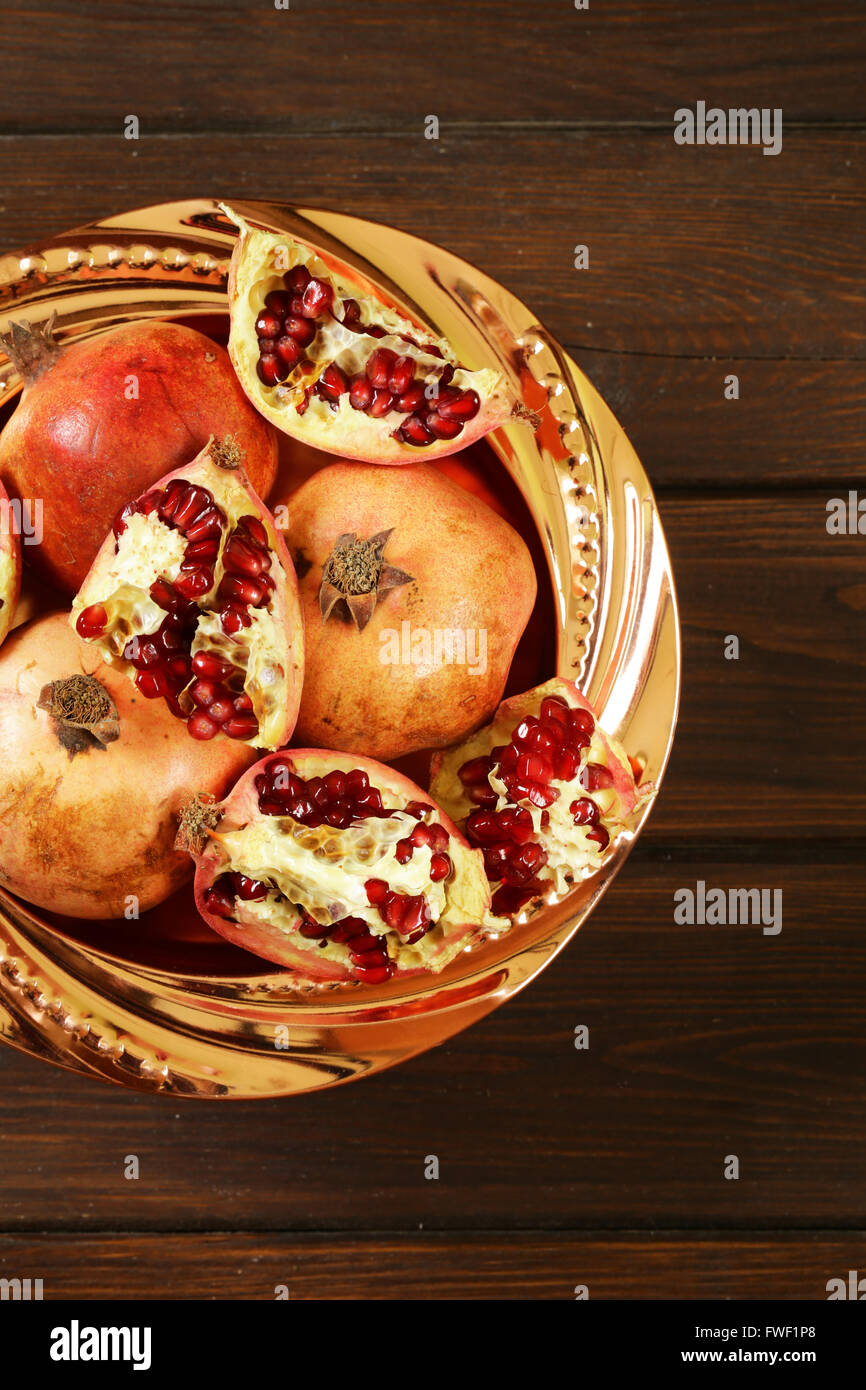 Organic ripe red fruit pomegranate, whole and broken - Stock Image