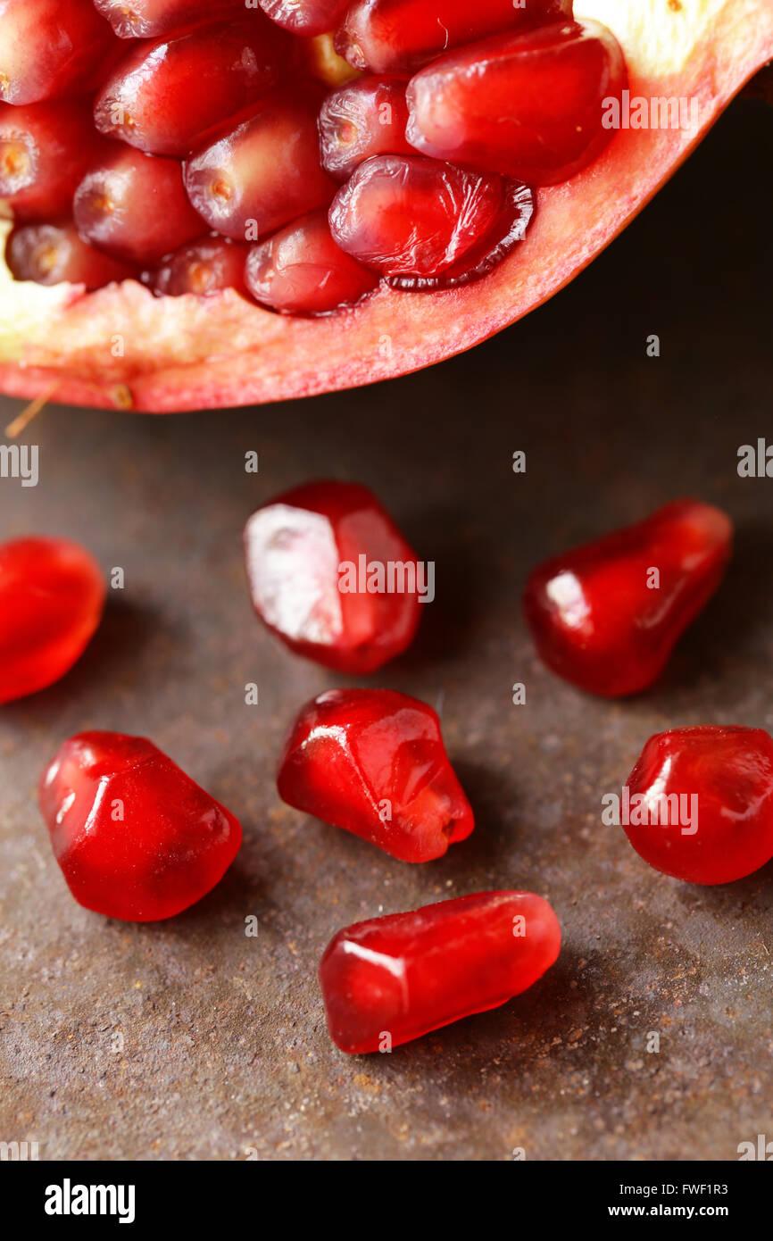 macro shot of organic ripe red fruit pomegranate seeds - Stock Image